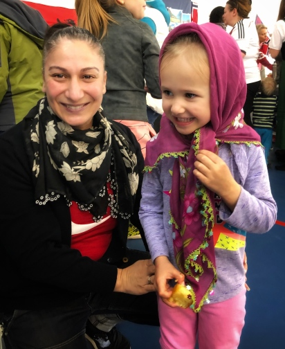 Willow trying on traditional Turkish scarves at the Turkish booth!