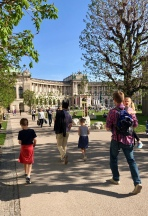 Walking along the park with the Hofburg in the distance