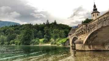 Green waters under the bridge in Lake Bohinj