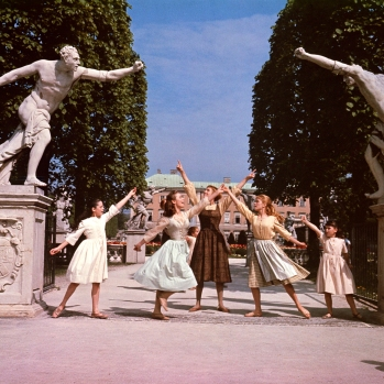 "This photo provided by Twentieth Century Fox Home Entertainment shows, from left, Angela Cartwright, as Brigitta, Chairmian Carr, as Liesl, Julie Andrews, as Maria, Heather Menzies, as Louisa, and Debbie Turner, as Marta, in a scene during the song, ""Do-Re-Mi,"" from the film, ""The Sound of Music."" The 1965 Oscar-winning film adaptation of the Rodgers & Hammerstein musical ""The Sound of Music"" is celebrating its 50th birthday this year. To honor the milestone, 20th Century Fox is releasing a five-disc Blu-ray/DVD/Digital HD collector's edition, the soundtrack is being re-released, the film will be screened at the TCM Classic Film Festival in Hollywood later this month and to over 500 movie theaters in April 2015. (AP Photo/Twentieth Century Fox Home Entertainment)"