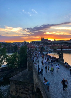 View of the Charles Bridge and Prague Castle at sunset