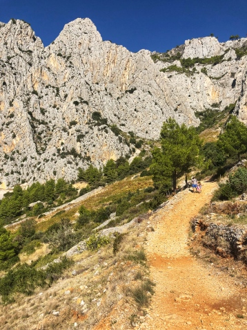 Climbing down the steep hills...